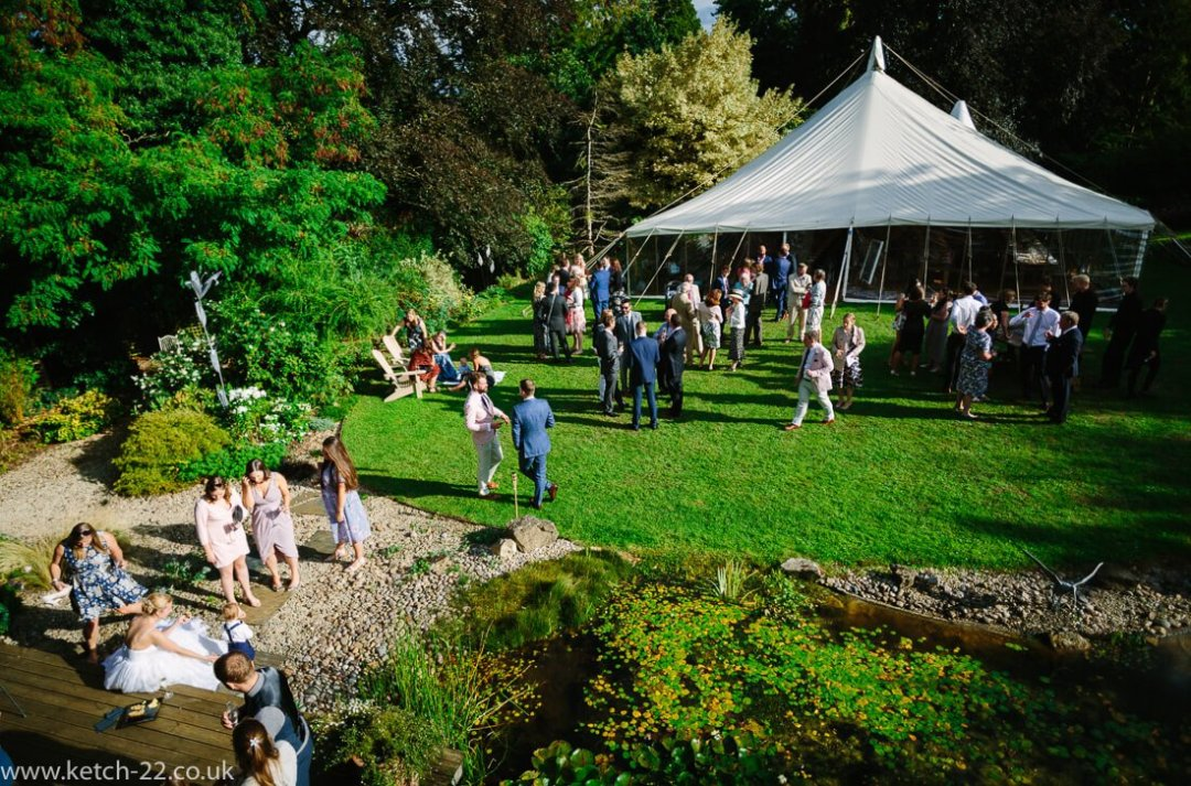 View of wedding marquee and guests