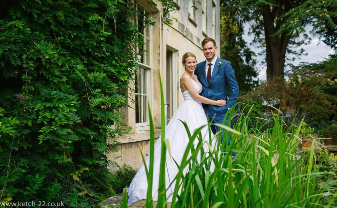 Wedding portrait of bride and groom in garden