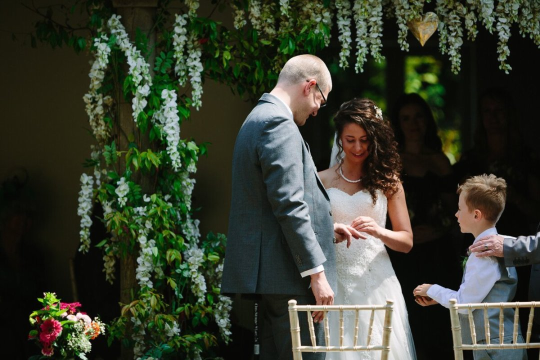 Exchanging wedding rings at ceremony