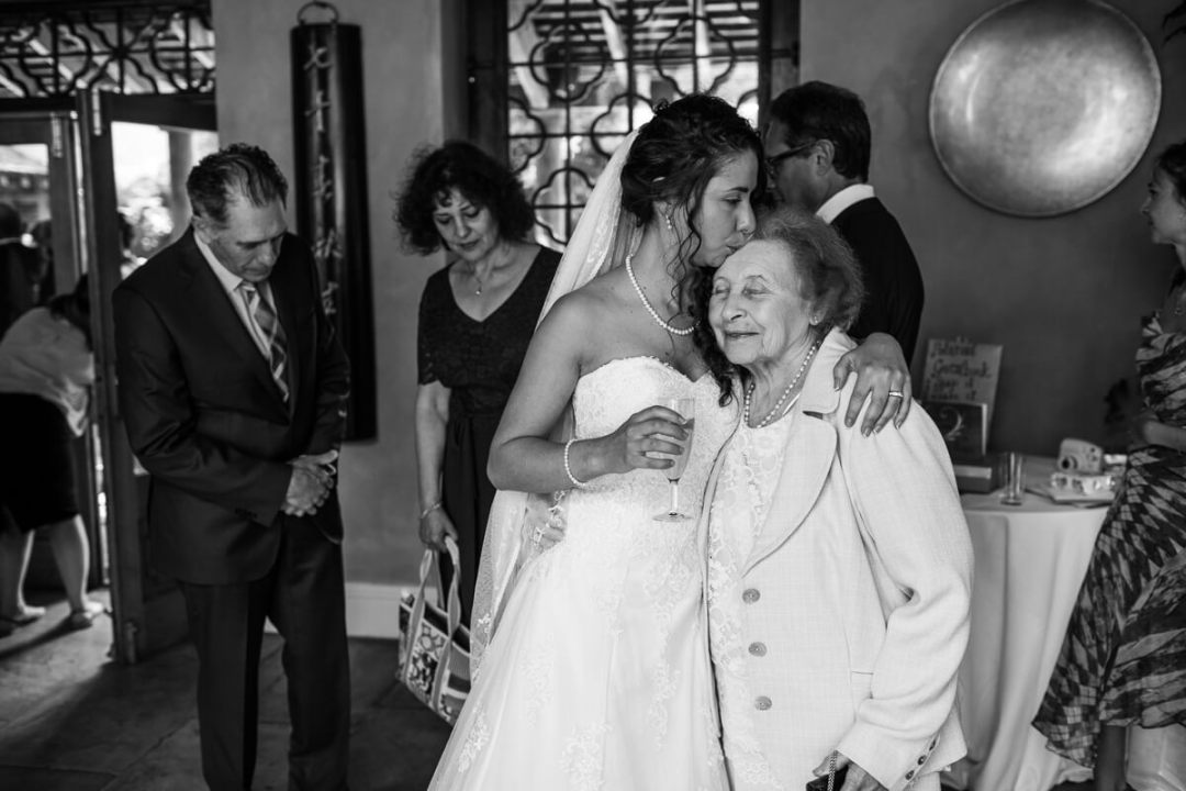 Bride kissing grand mother