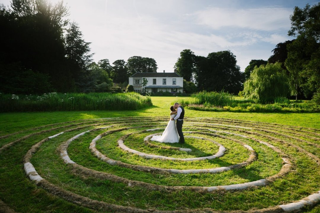 Bride and groom kissing in spiral circle