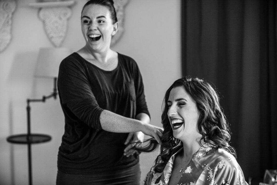 Bride laughing at wedding preparations