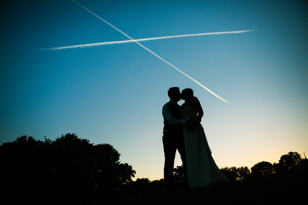 Documentary Wedding Photography Andalusia Spain / Bride and groom kissing at Sunset