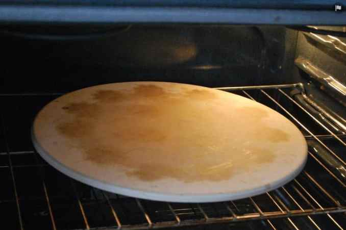preheating oven with a pizza stone inside
