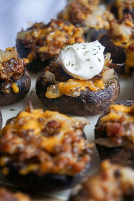 close up shot of mushrooms stuffed with sausage and cheese
