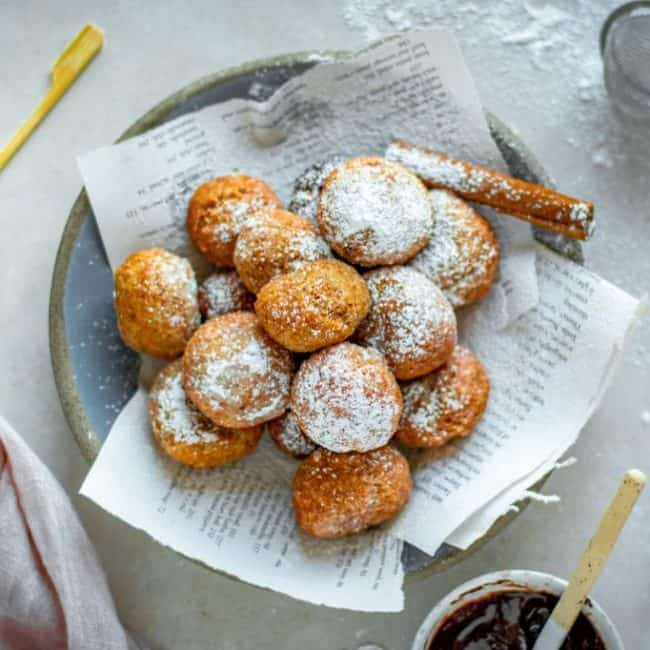 fried keto doughnuts topped with sugar next to chocolate
