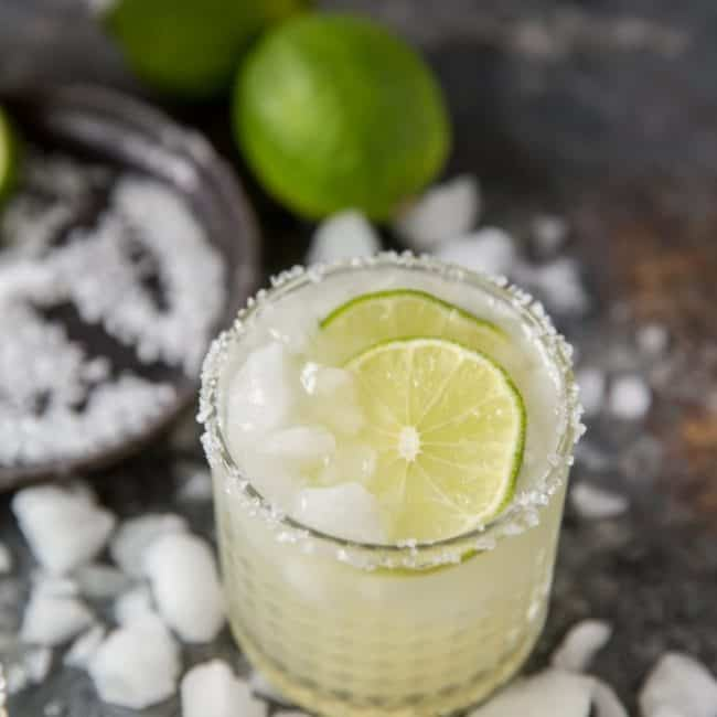 A single keto margarita with limes