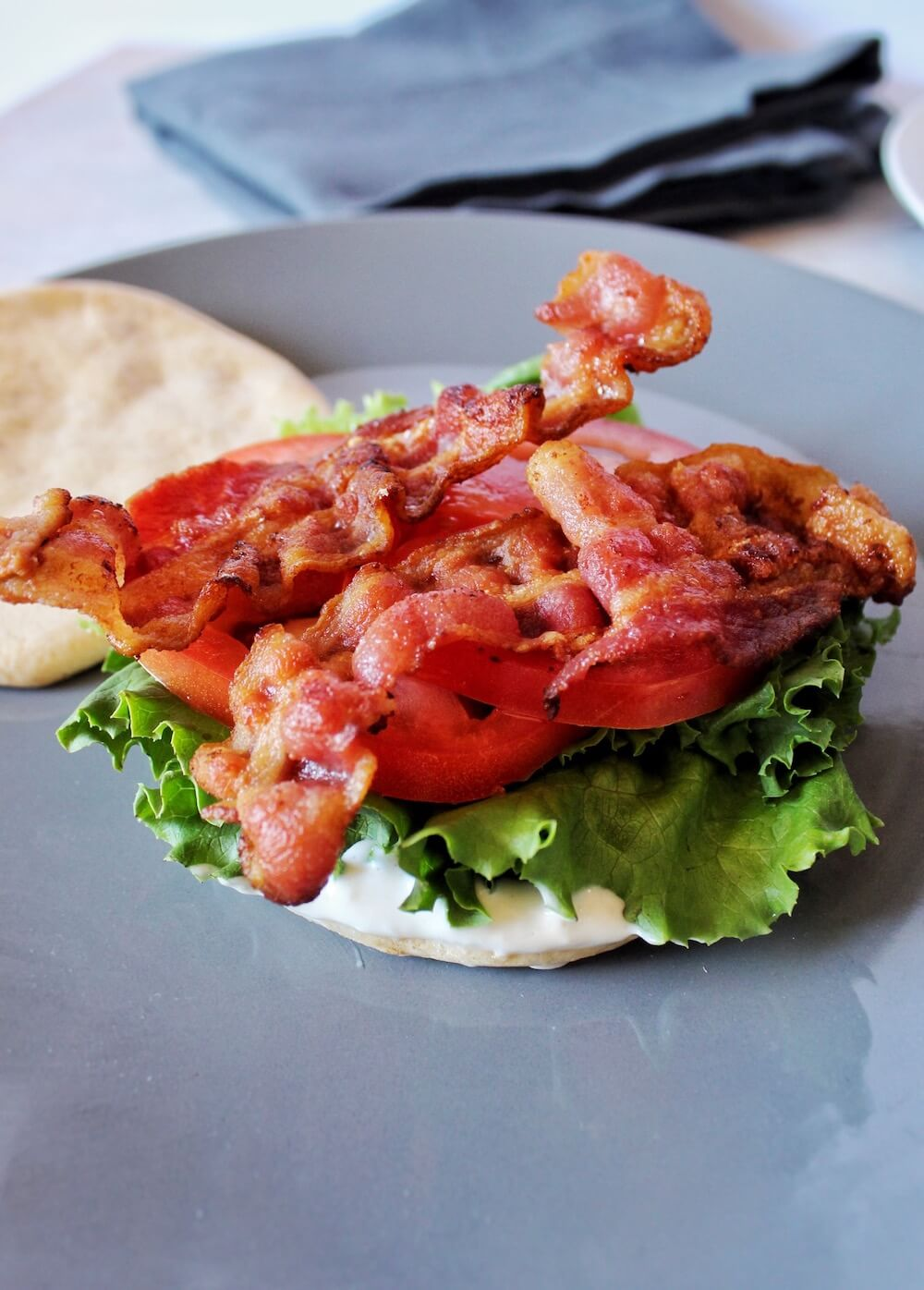 Perfectly cooked bacon atop Keto cloud bread makes this delicious BLT sandwich.