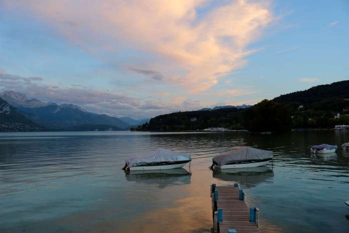 When you visit France, sit on the dock in the town of Annecy, France, watching a pink and blue sunset like this one, and contemplate why all the flowery, pink French toilet paper has a matching motif. ©KettiWilhelm2019