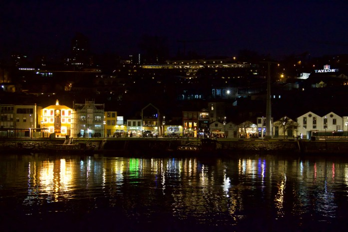 Lights reflecting on the Douro River at night from the port wine wineries in Vila Nova de Gaia. ©KettiWilhelm2020