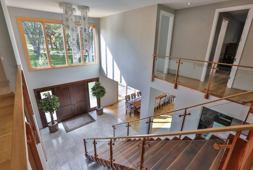 Custom Glass Railing For Stairs And Decks Keuka Studios   Modern Glass Stair Railing   Dark Wood   Banister   Wall Mounted   Cost   Basement