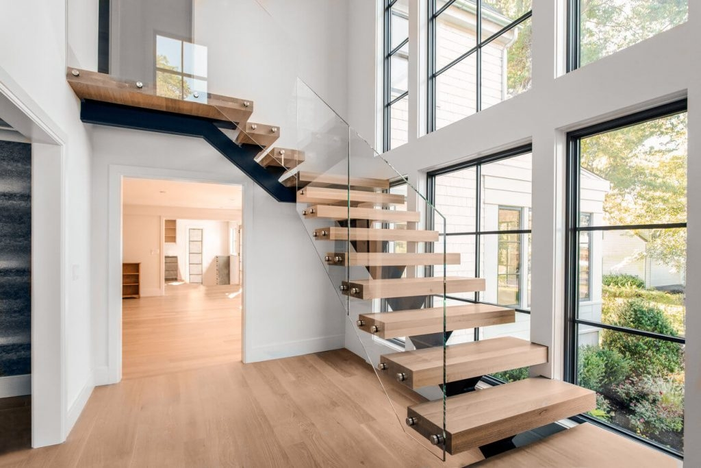 How Much Do Custom Floating Stairs Cost Keuka Studios | Floating Stairs With Glass Railing | Wall | Commercial | Glass Staircase | Thin Glass | Modern