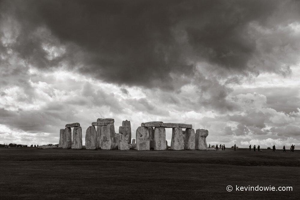 Stonehenge under threatening sky. Black and white.
