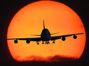 Boeing 747 flying out of the sun