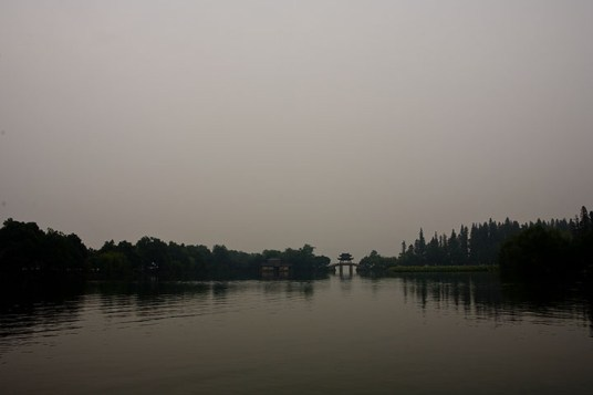 View of the Su Causeway over the West Lake in Hangzhou.