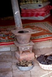 The little stove, with coal for fuel and dried dung as kindling.