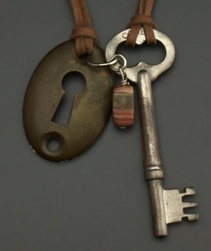 """American """"Owl Eye"""" Key with Escutcheon, on doe skin - $43 (SW814)"""