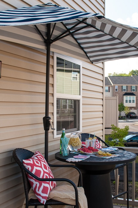 Look at how she decorates this small space townhome porch! Perfect for summer! I love all the bright colors