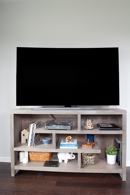 How to design a modern media center using IKEA BESTA cabinets. Get a built-in look on a budget.