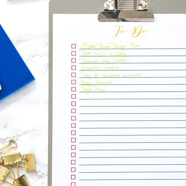 to-do list on a clipboard with office supplies
