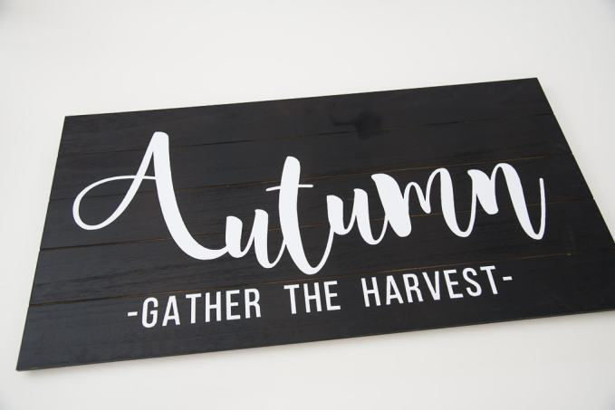 Black wooden pallet with a white vinyl design Autumn lettering