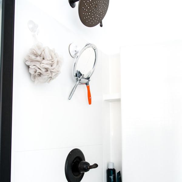 Moen Velocity Shower Head installed in a white shower in a master bathroom