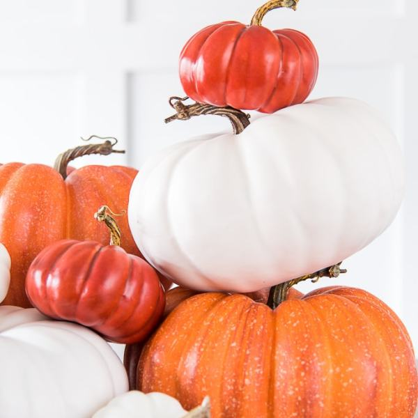 orange and white stacked pumpkins on a table