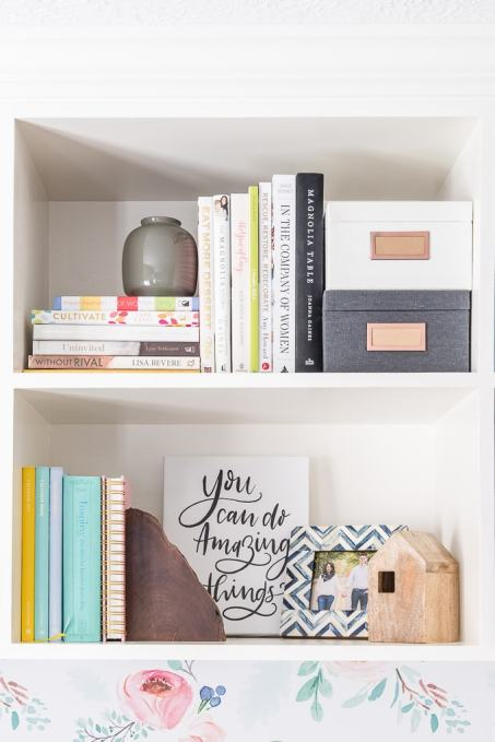 styled bookshelves with colorful and gray accent pieces