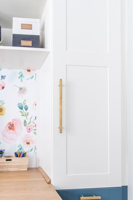 white cabinet door with gold hardware