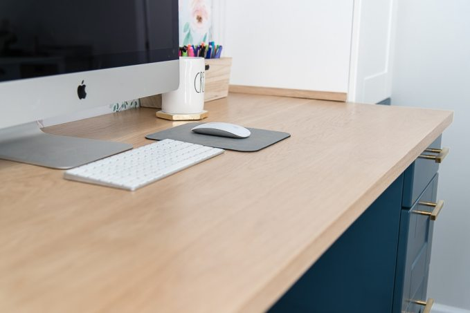 white oak wooden desk top countertop with a computer