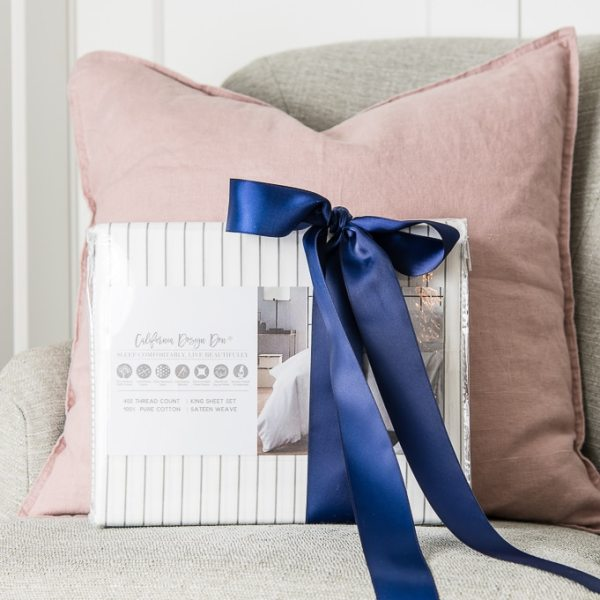 California Design Den white and gray striped sheets with a navy blue bow pink pillow