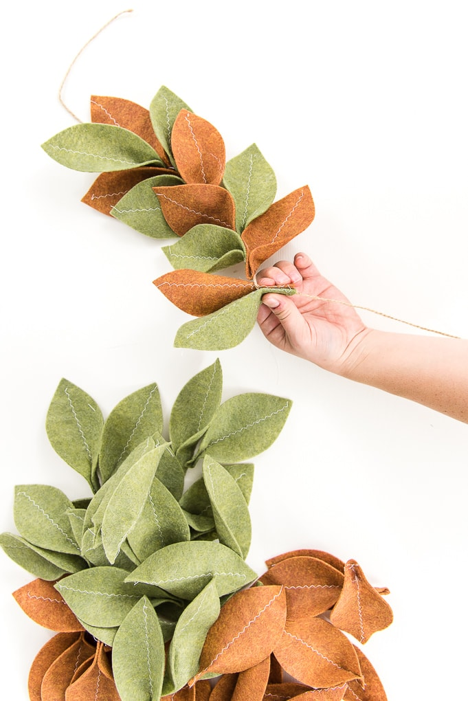 hand pinching leaves felt magnolia garland green and tan leaves