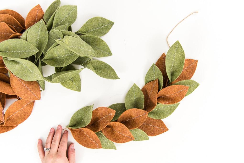 assembling felt magnolia garland green and tan leaves