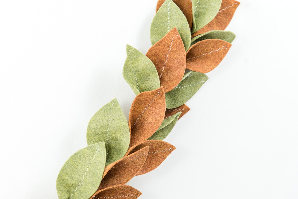 close up of finished felt magnolia garland green and tan leaves