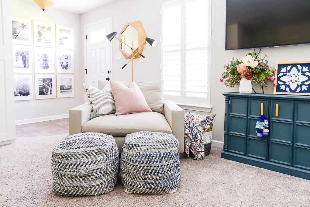 West Elm Harmony chair with blue poufs in basement office room