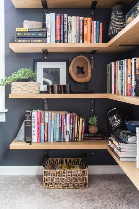 close up of floating bookshelves with books and decorations