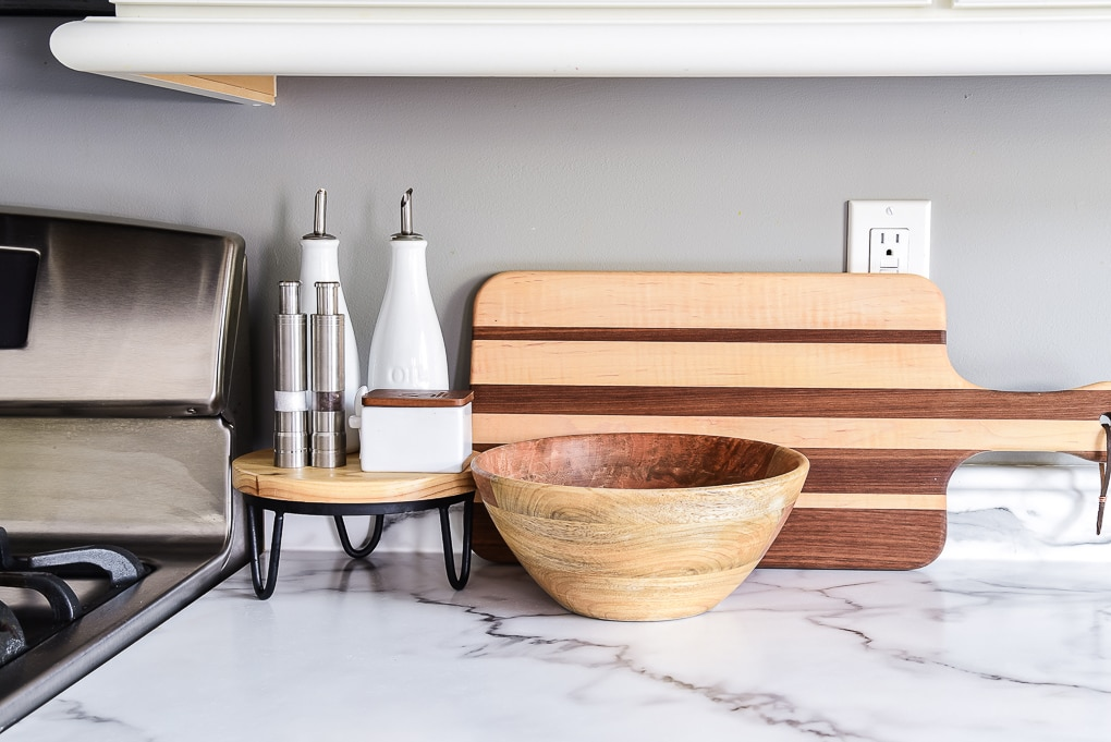 modern classic kitchen decorations cutting board natural wood bowl and salt and pepper grinders