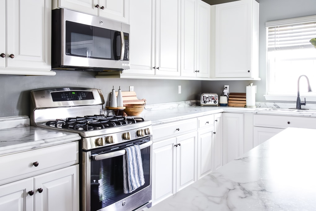 white kitchen cabinets and stove