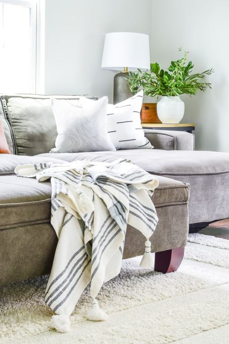 throw blanket on ottoman in living room