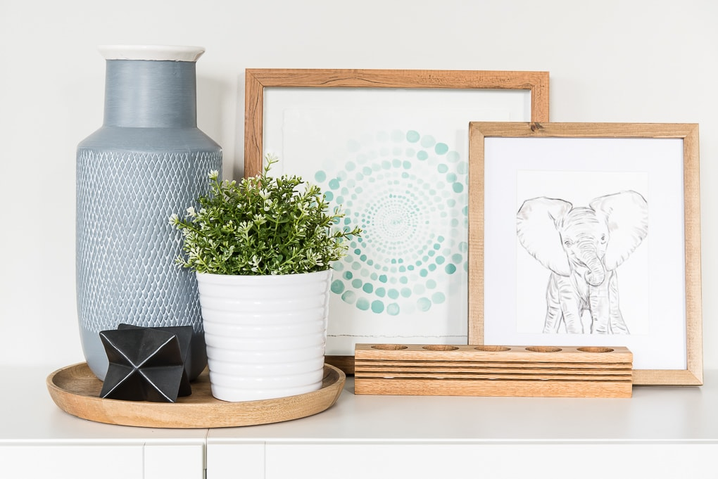 modern artwork with home decor on a table