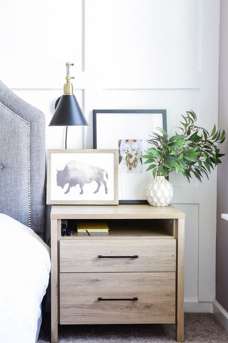 modern artwork in a bedroom on a nightstand