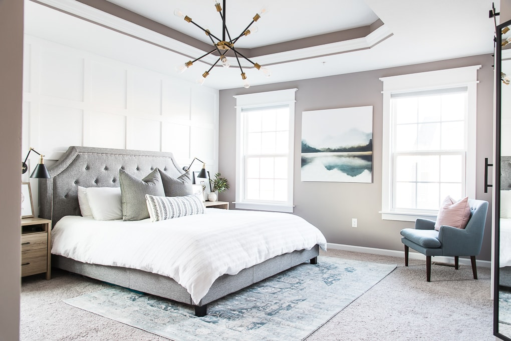 modern master bedroom with large abstract artwork