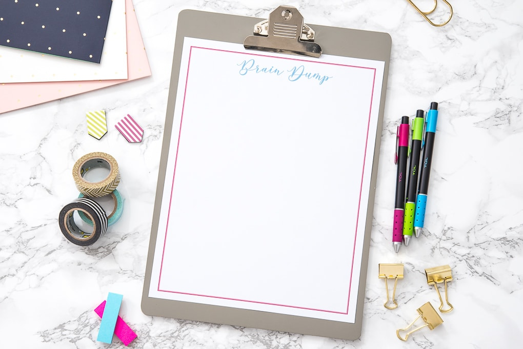 blank free printable brain dump worksheet on a desk with pretty accessories