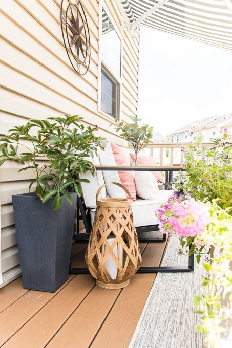outdoor porch with planters and wooden lantern