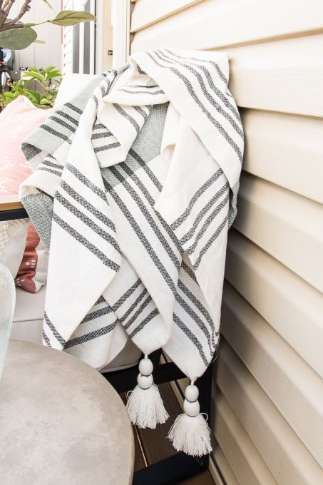 gray and white outdoor blanket