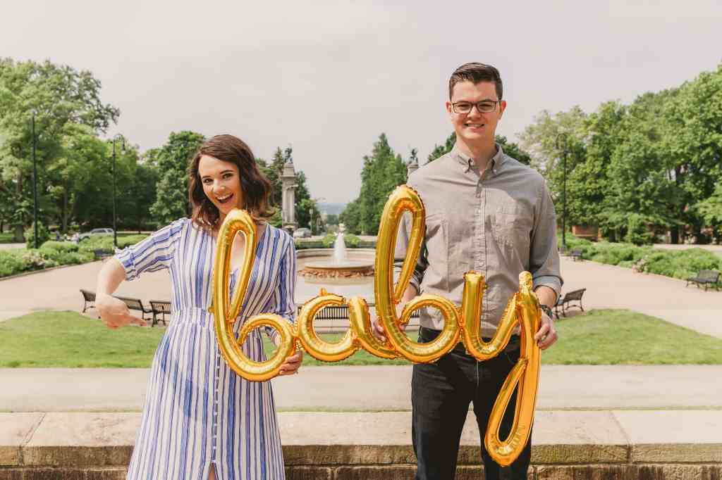 baby announcement photo couple with gold balloon