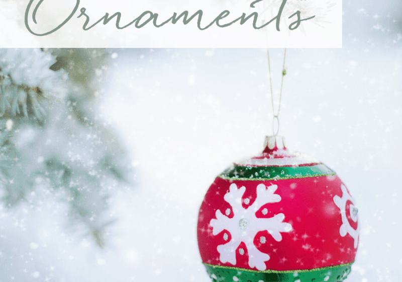 Red and Green Christmas Ornament with snowy background tree