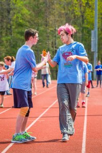 Students running relay race.
