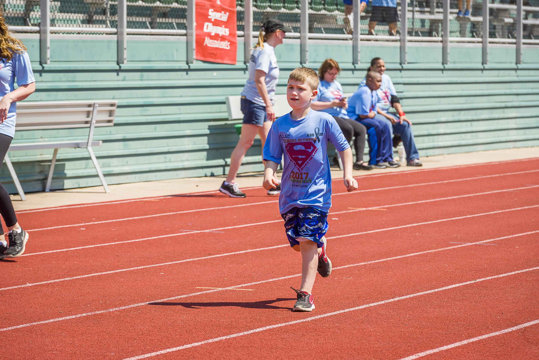 Student running on track.