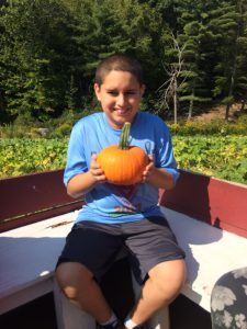 Student with his pumpkin.
